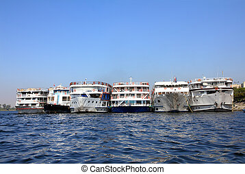 old passenger ships standing in port on Nile