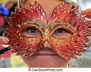At the Carnival - Young blue eyed gril with mardi gras mask.