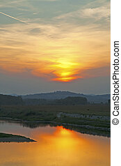River - Beautiful orange sunset on the river, vertical image