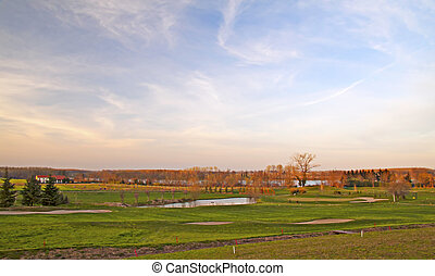 Golf field - View of a golf hole in a course, with little...