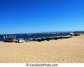 Beach Scene with Boats Near the Ocean