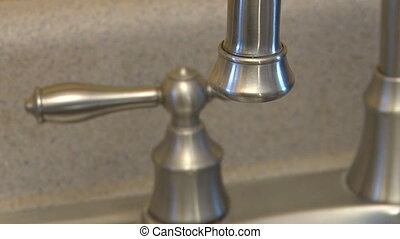 Leaking faucet dripping - Slowly dripping faucet with handle...