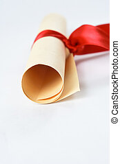 Diploma Scroll and Red Ribbon - A rolled scroll of parchment...