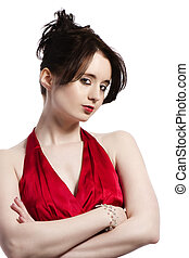 portrait of a young beautiful woman in red evening dress