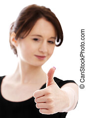 young pretty woman in black shirt shows thumb up
