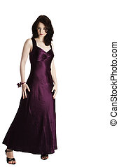 young beautiful woman standing in purple evening dress