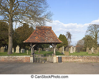 rural churchyard - an english landscape with a view of a...