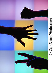 Hand silhouettes, rock paper scissors - This photograph...