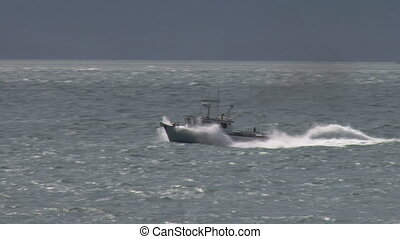 Fast fishing boat in high seas - Small Alaskan fishing...