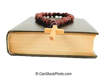 Old religious books on white