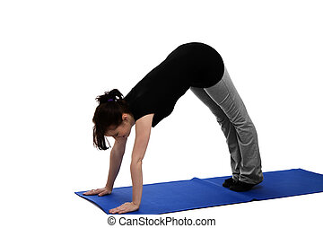 young woman exercising yoga on blue mat