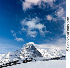 Eiger - Ski slope in the background of Mount Eiger The Eiger...