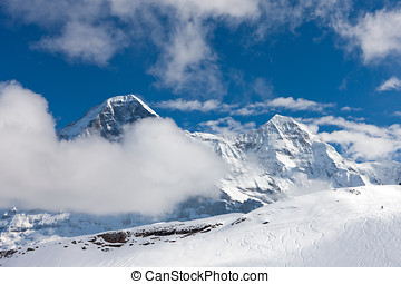 Eiger - Ski slope in the background of Mount Eiger. The...