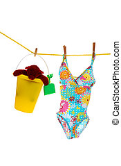 bathing suit toys on clothes line
