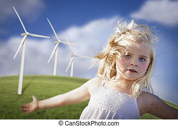 Beautiful Young Girl Playing in Wind Turbine Field -...