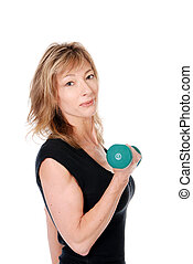 older woman holding a dumbell