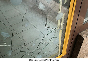 Broken glass  of the entrance of a shop