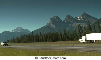 Semi trailer truck on mountain highway