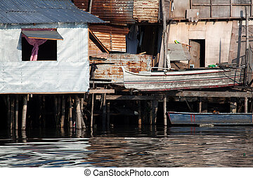 shanty squatter homes along river in Asia - Shanty squatter...