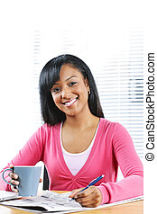 Young smiling woman looking for job - Happy young black...