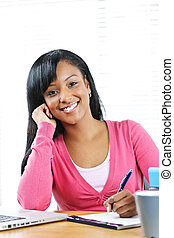 Happy female student studying - Portrait of smiling young...