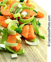 Chopped vegetables on wooden board - Fresh chopped...