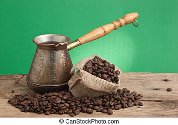 bag of coffee beans and an coffee maker