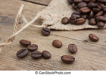 coffee beans in a bag on a wooden background