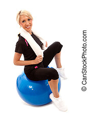Gym Ball - A female sat on a blue gym ball with a white...