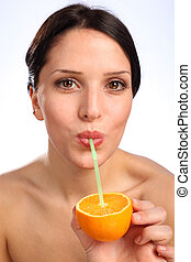 Vitamin C orange fruit juice drink for young woman
