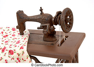 old sewing machine isolated on white background