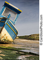 Ship in low tide before the storm - Ship in low tide. High...
