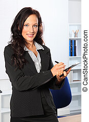 Beautiful smiling woman at work with clipboard