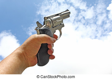 Magnum Revolver - Close up of man hand and 357 magnum...