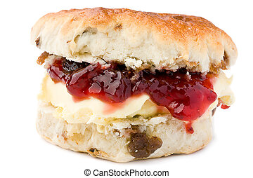 Scone with jam and clotted cream. - Scone with strawberry...