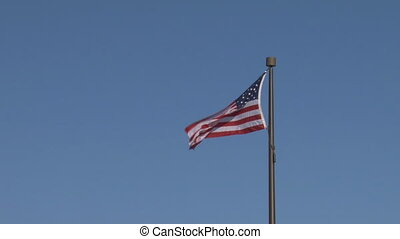 Flag: Unites States of America - The American flag flies to...
