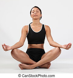 Girl in meditation pose - Girl eyes closed relaxing in...