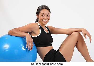 Fitness on an exercise ball - Fit young woman in black...