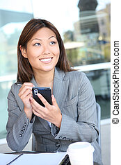Pretty Asian Business Woman Texting - A young, pretty asian...
