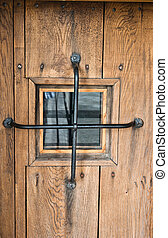 Old door with a window, a close up