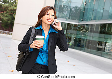 Asian Business Woman - A pretty asian business woman walking...