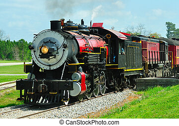 Baldwin Locomotive - Steam engine and car stop at the depot...