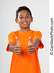 School boy gives two thumbs up - Teenager boy gives two...
