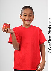 Cute school boy with red apple