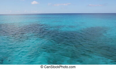 Travelling over Caribbean water. - View of colourful and...