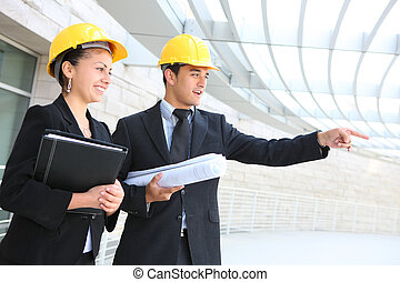 Architects on Construction Site - Man and woman business...
