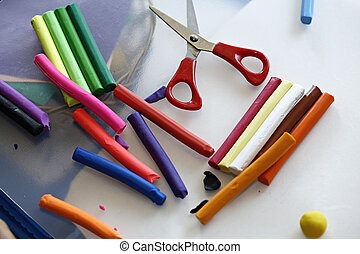 Colorful clay dough plasticine and scissors