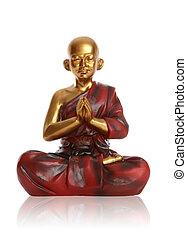 Monk Praying Over White - A religious spiritual golden monk...
