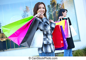 Pretty Woman Shopping with Colorful Bags - A pretty woman...