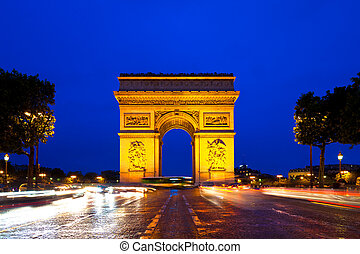 Triumphal Arch in Paris, France - Evening traffic on...